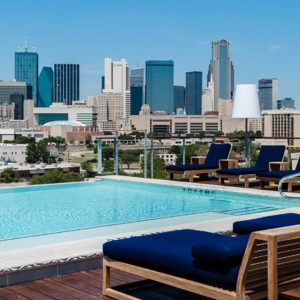 Infinity pool rooftop area with lounge chairs at CANVAS Hotel Dallas