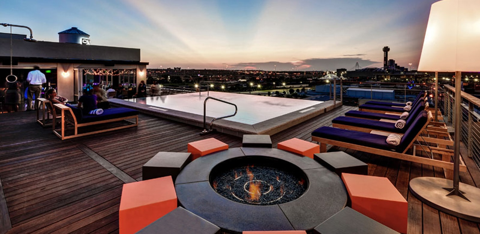 Fire pit by infinity pool at CANVAS Hotel in Dallas