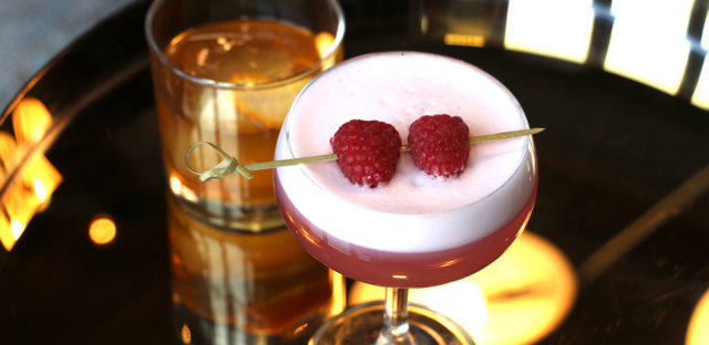 Cocktail with fresh raspberries